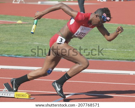 July 27, 2014 Eugene, Oregon - - USA's Shamier Little comes out of the blocks to lead off the women's 4X400 relay race in the 2014 IAAF Junior World Championships at Hayward Field