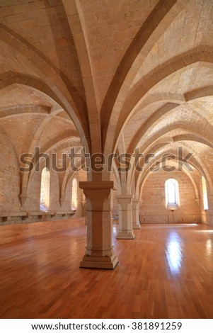 July 15, 2015: Gothic architecture of the meeting hall of the Royal Abbey of Santa Maria de Poblet (Poblet Monastery) in Catalonia, Spain