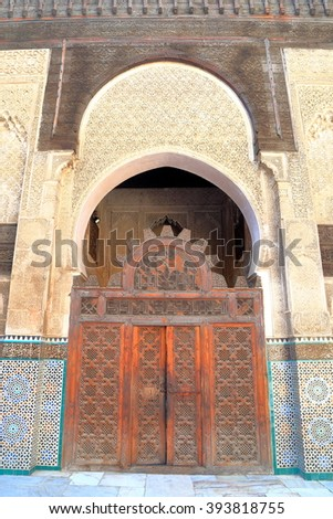 JULY 09, 2015: Highly decorated Berber gate inside Bou Inania Madrasa in Fes, Morocco