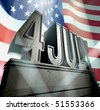 July 4 in silver letters on a silver pedestal in sunbeams in front of  the American flag - stock