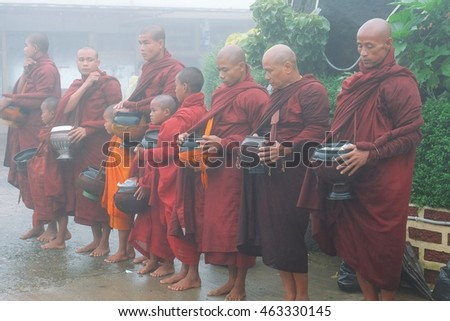 July 31, 2016, Mon state, Myanmar. Buddhist monk walk receive food in the morning, among cold weather and fog