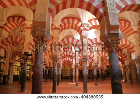 July 12, 2015: Moorish architecture of the columns and arches inside the Cathedral (Mosque / Mezquita) in Cordoba, Andalusia, Spain