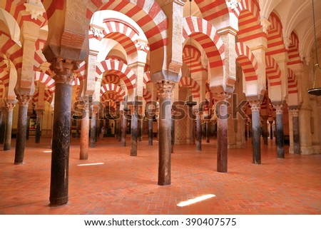July 12, 2015: Moorish design of the arches and columns inside the Cathedral (Mosque / Mezquita) in Cordoba, Andalusia, Spain