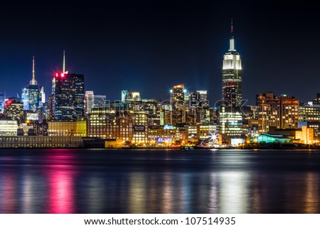 July 2012. Night view of Empire State Building and Midtown Manhattan skyline across the Hudson River from Hoboken, NJ. - stock photo