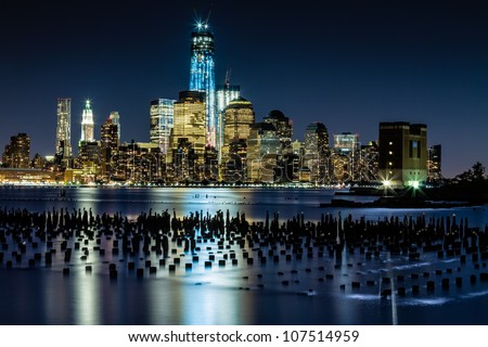 July 2012. Night view of the Freedom Tower and Downtown Manhattan skyline across the Hudson River from Hoboken, NJ. - stock photo