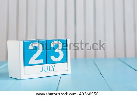 July 23rd. Image of july 23 wooden color calendar on white background. Summer day. Empty space for text. National Hot Dog Day. World Whale and Dolphin DAY - stock photo