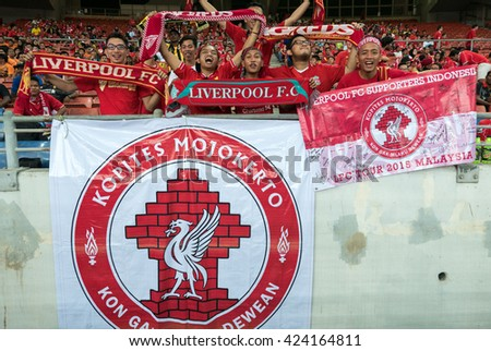 July 24, 2015 - Shah Alam, Malaysia: Fans and supporters show their support for the visiting Liverpool team in their friendly match against Malaysia. Liverpool FC from England is on an Asia tour. - stock photo