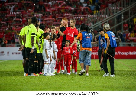 July 24, 2015- Shah Alam, Malaysia: Liverpool players (red) meets Malaysian players (green) before the start of their friendly game. Liverpool Football Club from England is on an Asia tour. - stock photo