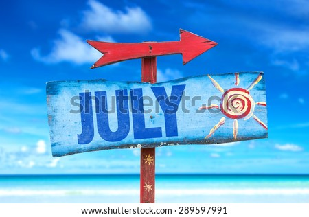 July sign with beach background - stock photo