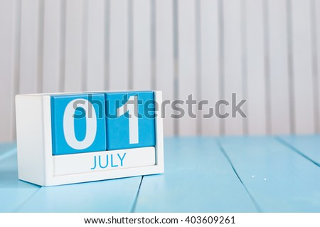 July 1st. Image of july 1 wooden color calendar on white background. Summer day. Empty space for text - stock photo