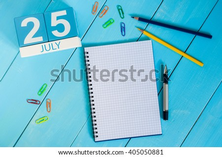 July 25th. Image of july 25 wooden color calendar on blue background. Summer day. Empty space for text - stock photo