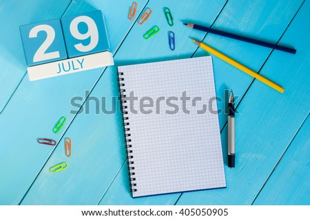 July 29th. Image of july 29 wooden color calendar on blue background. Summer day. Empty space for text. System Administrator Appreciation Day - stock photo