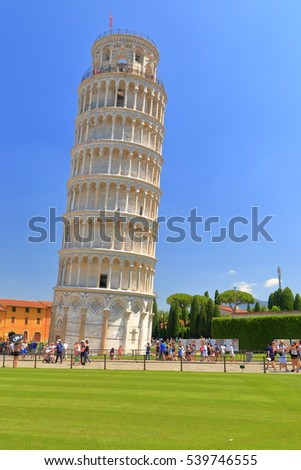 July 01, 2016: Tourists visit the Leaning Tower in Piazza dei Miracoli (Square of Miracles), Pisa, Tuscany, Italy
