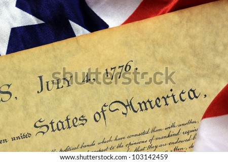 July 4, 1776 - United States of America Constitution and USA Flag - stock photo