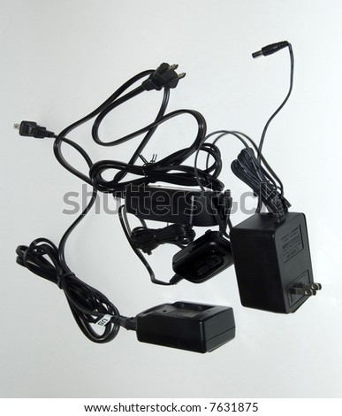 jumble of wire connectors and plugs black on white - stock photo