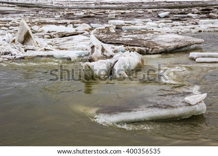 Jumbles of dirty ice thunder down the Tanana River in early spring - stock photo