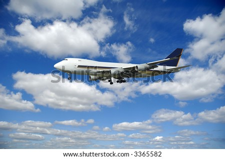 Jumbo is flying in a clouded sky. - stock photo