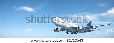 Jumbo jet aircraft is maneuvering in a blue sky. Panoramic composition. - stock photo