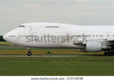 Jumbo jet airplane is taxiing prior to departure - stock photo