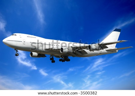 Jumbo jet and blue and cloudy sky. - stock photo