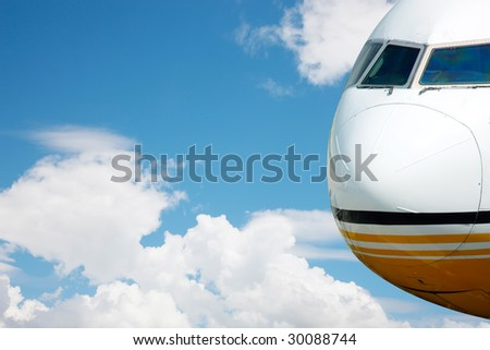 jumbo jet in mid flight with sky clouds in the background - stock photo