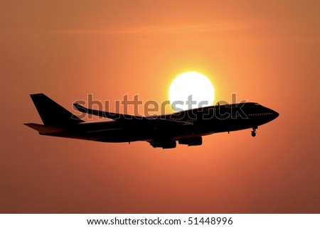 jumbo jet on sunset
