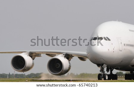 Jumbo jet taking off - stock photo