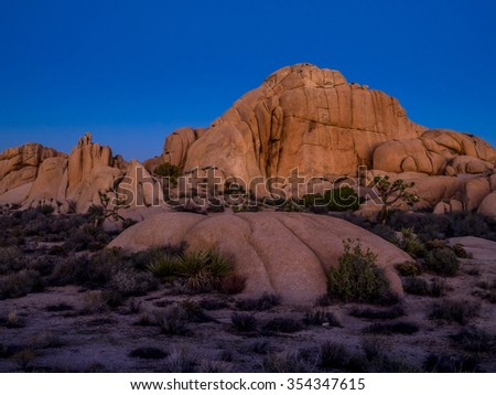 Jumbo Rocks after sunset n Joshua Tree National Park, California, USA, where the Mojave and Colorado desert ecosystems meet.