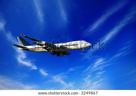 Jumbojet, blue sky and clouds - stock photo