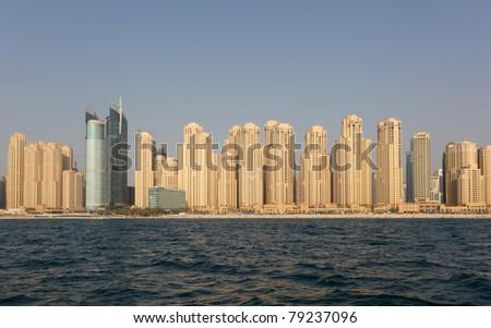 Jumeirah Beach Residence as seen from the sea. Dubai, United Arab Emirates - stock photo
