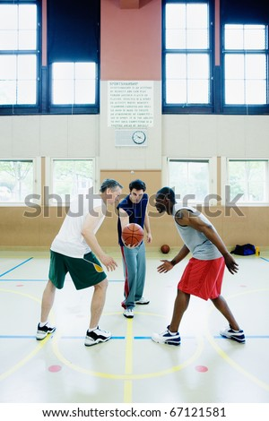 Jump ball in basketball game - stock photo