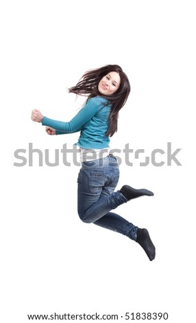 Jump of happy joyful young woman on white