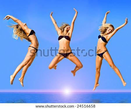 Jump of the young girl on a beach - stock photo