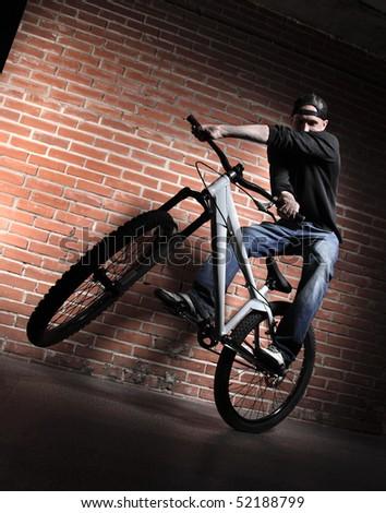 jump on BMX bicycle - stock photo
