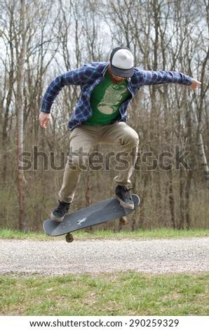 Jump on skateboard - stock photo