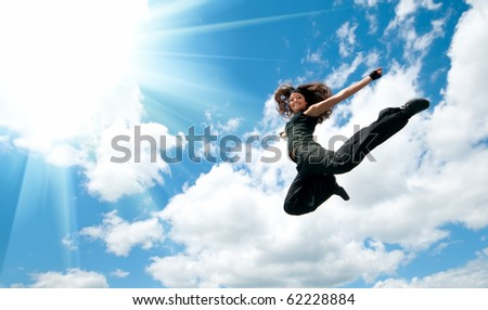 Jump over blue sky - stock photo