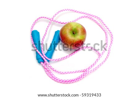 Jump rope and apple (high angle view) - stock photo