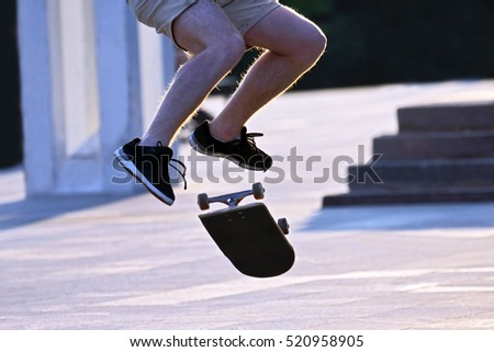 jump to bowl a guy on a skateboard