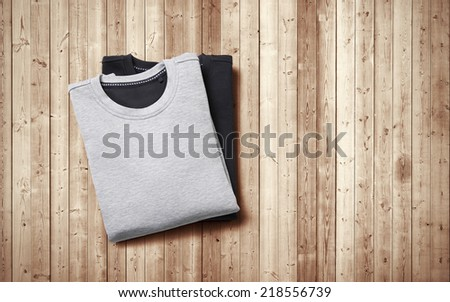Jumpers on wood background - stock photo