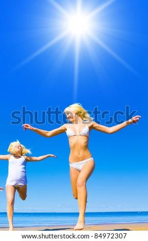 Jumping Blonde Beauties - stock photo