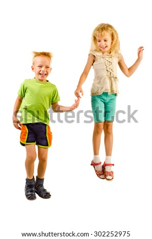 jumping boy and girl isolated on a white background