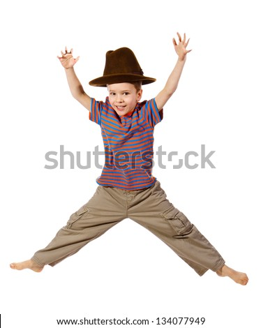 Jumping boy in big hat, isolated on white - stock photo