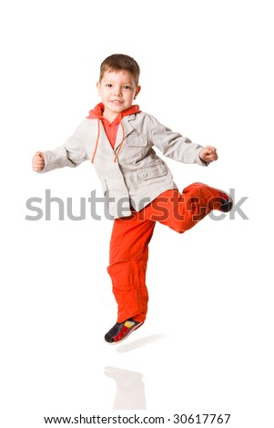Jumping boy wearing vivid pants isolated on white - stock photo