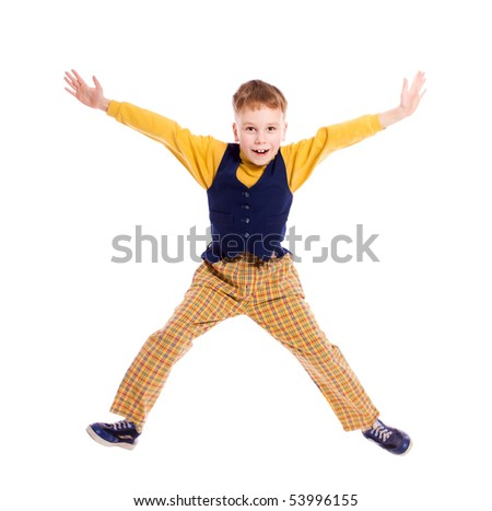 Jumping boy wearing vivid pants isolated on white