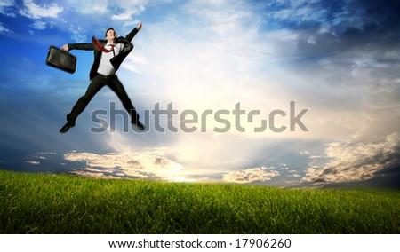 Jumping business man on Green Field - stock photo