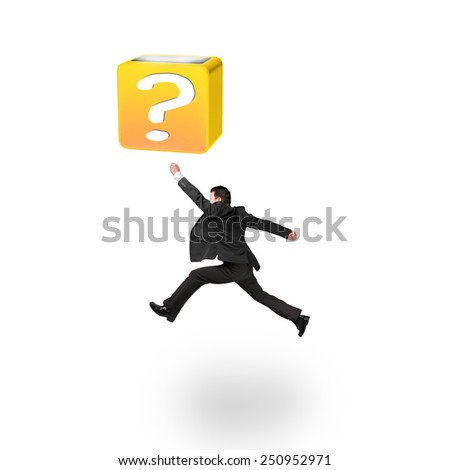 Jumping businessman hitting 3d question mark box isolated on white background - stock photo