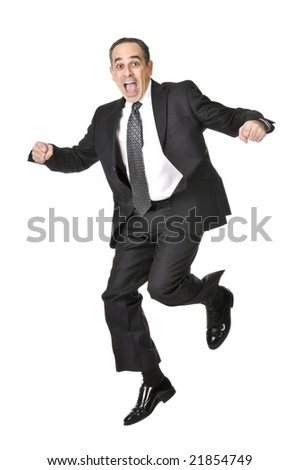 Jumping businessman in a suit isolated on white background