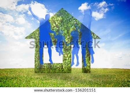 Jumping family and green house against sky background - stock photo