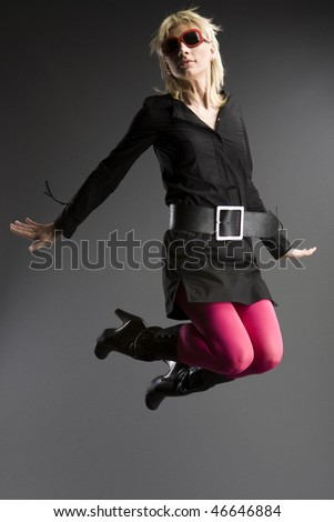 Jumping girl - stock photo