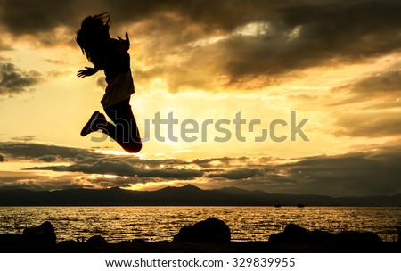 jumping girl and sunset